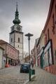 Haaskova ulice a věž kostela sv. Martina